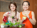 Two women with  sprouts Stock Images