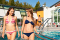 Two women in swimming pool Royalty Free Stock Photo