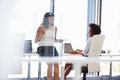 Two women talking in an office Royalty Free Stock Photo