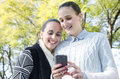 Two women using a mobile phone Royalty Free Stock Photography