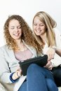 Two women using tablet computer Royalty Free Stock Photo