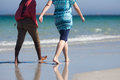 Two women walking along the beach Royalty Free Stock Photography
