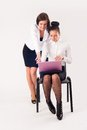 Two women work in team young businesswoman with laptop at white background Stock Images