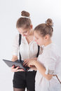 Two women working with laptop girls in hand Stock Photography