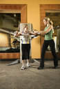 Two women working out. Royalty Free Stock Photos