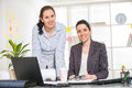 Two women working together in design studio female architects designing selective focus Royalty Free Stock Photo