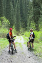 Two womens on bikes in spring forest Royalty Free Stock Photos