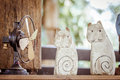 Two wood carving cats with old fans Royalty Free Stock Photo