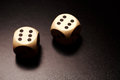 Two wooden dices on a black background Royalty Free Stock Photo