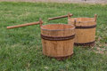 Two Wooden Pails on Meadow Royalty Free Stock Photo
