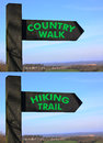 Two wooden rural signs for a country walk or a hiking trail against a blue sky with a blurred background Stock Image