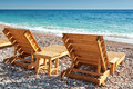 Two wooden sun loungers on adriatic sea coast stand the in montenegro Stock Photo