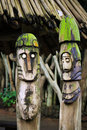 Two wooden totems (idols) near Royalty Free Stock Photo