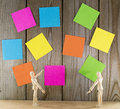 Two wooden toys with wall papers puppet man full of post it Royalty Free Stock Image