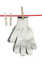 Two working gloves clothesline over white background Royalty Free Stock Images