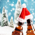 Two xmas beer bottles clink together Royalty Free Stock Photo