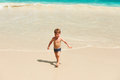 Two year old boy playing on beach baby at seychelles Stock Photo