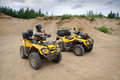 Two yellow atv man having rest in Stock Photography