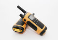 Two yellow and black portable radio set on the light background concept of wireless communications Stock Photography
