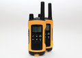 Two yellow and black portable radio set on the light background concept of wireless communications Stock Images