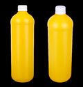 Two yellow containers for hygiene products Royalty Free Stock Photos