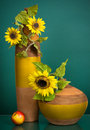 Two yellow vases with sunflowers Stock Images