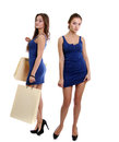 Two young adult woman with colored bags Royalty Free Stock Photo