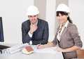 Two young architects in the meeting Royalty Free Stock Photo