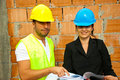 Two young architects on site Royalty Free Stock Photo