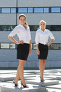 Two young attractive business women posing outdoor and successful Stock Photo
