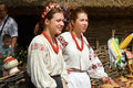 Two young beautiful girls in outdoor ethnic village Pirogovo, Ki Royalty Free Stock Photo