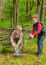 Two young boys extinguishing a small fire Royalty Free Stock Photo