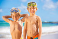 Two young boys having fun on tropcial beach tropical happy best friends playing Royalty Free Stock Photography