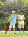 Two young boys playing baseball Royalty Free Stock Images