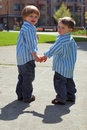 Two Young Brothers - Holding Hands Royalty Free Stock Images