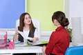 Two young business lady negotiate. Royalty Free Stock Photo