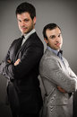 Two young business men image of standing back to back Stock Photography