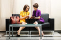 Two young fashion woman reading a magazine Royalty Free Stock Photo