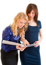 Two young business women discussing documents Stock Images