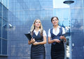 Two young businesswomen in formal clothes Royalty Free Stock Photography