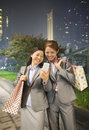 Two young businesswomen smiling and taking a picture of themselves with cell phone Royalty Free Stock Photos