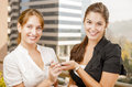 Two young executive women sharing information Royalty Free Stock Photos