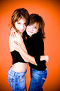 Two Young Female Friends Hug Stock Photo