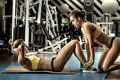 Two young fitness woman execute exercise Royalty Free Stock Photo