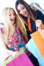 Two young friends shopping together happy in town Stock Images
