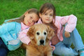 image photo : Two young girl and dog