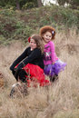Two young girls on bike vintage photograph of in frilly tutus a in an overgrown wooded area Stock Photography