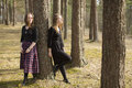 Two young girls close friends walk in a pine forest. Nature. Royalty Free Stock Photo
