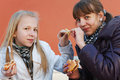 Two young girls eating a burgers Royalty Free Stock Photography