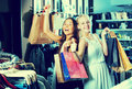 Two young girls having many shopping bags Royalty Free Stock Photo
